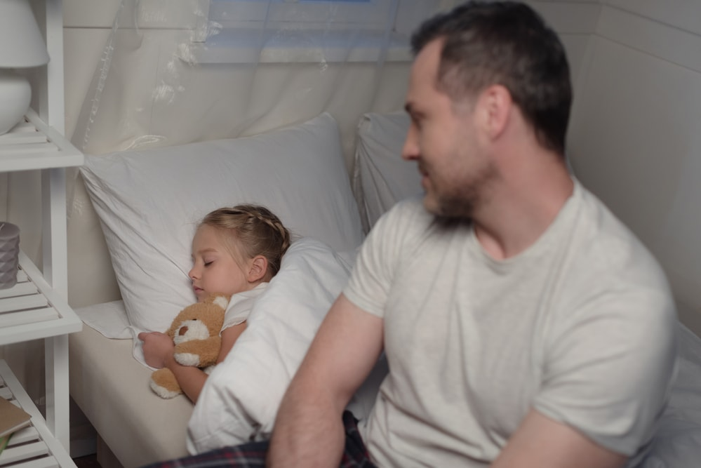 How can I help my young daughter with her anxiety at bedtime?