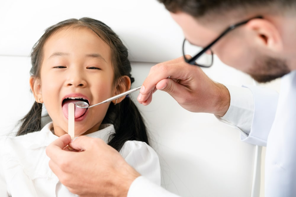 My child is afraid of going to the dentist. What should I do?